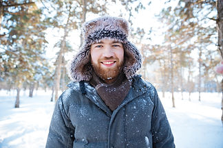 man-standing-in-winter-park-PYZSLB5.JPG