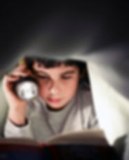 young-boy-school-child-reading-book-at-n