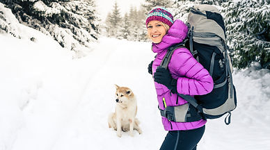 happy-girl-hiking-in-winter-forest-with-