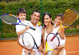 bigstock-Happy-family-playing-tennis-ho-