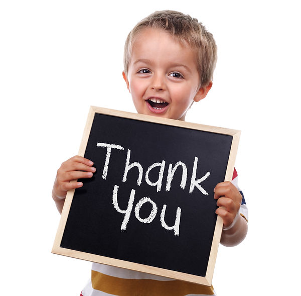 Child holding a thank you sign standing