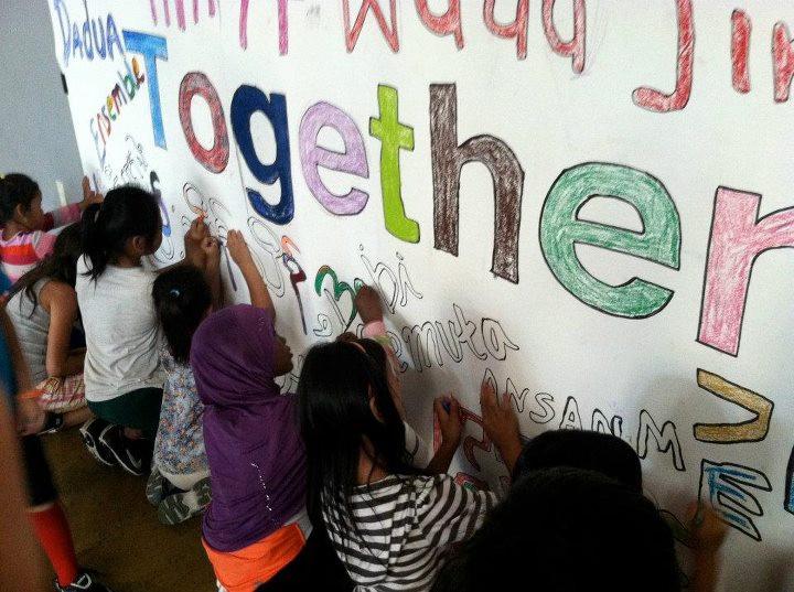 Together mural making at SWB Oakland.jpeg