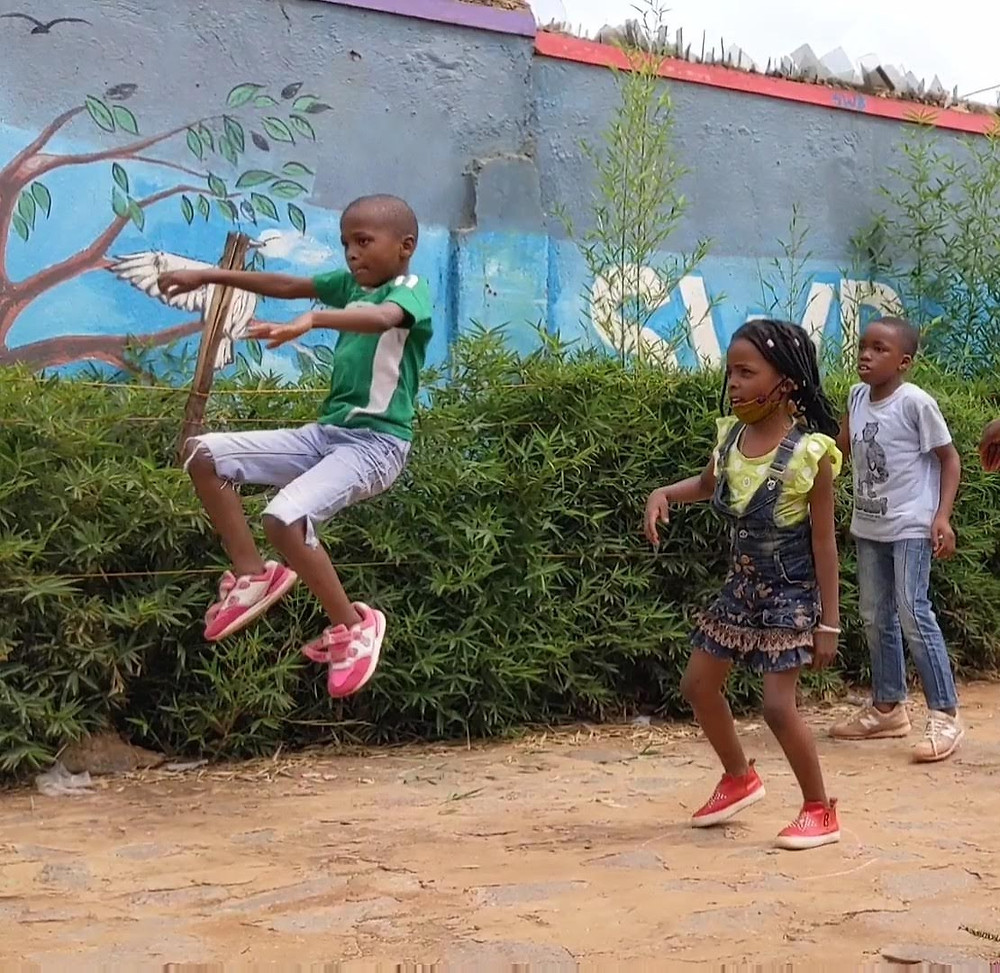 Children playing outside the SWB youth center in Kampala, Uganda