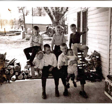 Roberson Cousins on Porch Swing - April