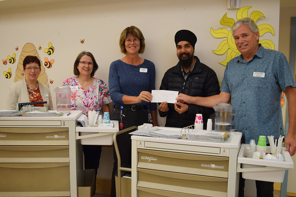 From left to right: Carol Chipman (president of the WCGH Foundation), Marianne Johnson (LPN), Kim Love (clinical nurse lead at Westhaven), Paramjeet Singh (Guru Nanak Sikh Society) and Chris Francey (WCGH Foundation director) stand beside Westhaven's new medical carts. ELENA RARDON PHOTO