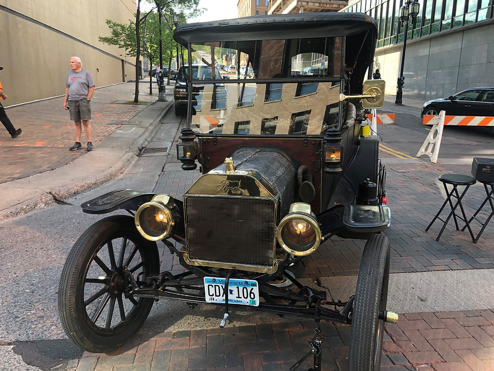 1914 Model T Touring car with headlights lit