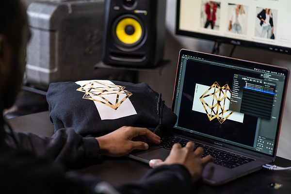 Kevin Kneelad creating graphic for DMND MOB clothing brand