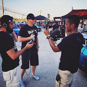 On set filming interview during production of Hot Import Nights car show