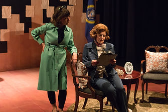 Ann Cullen (Robin Abrahams) confers with