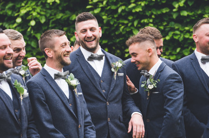 Groom laughing at homewood park bath wedding