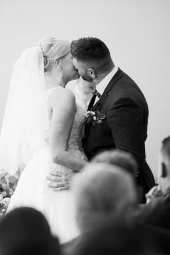 first kiss bride and groom at homewood park bath wedding venue