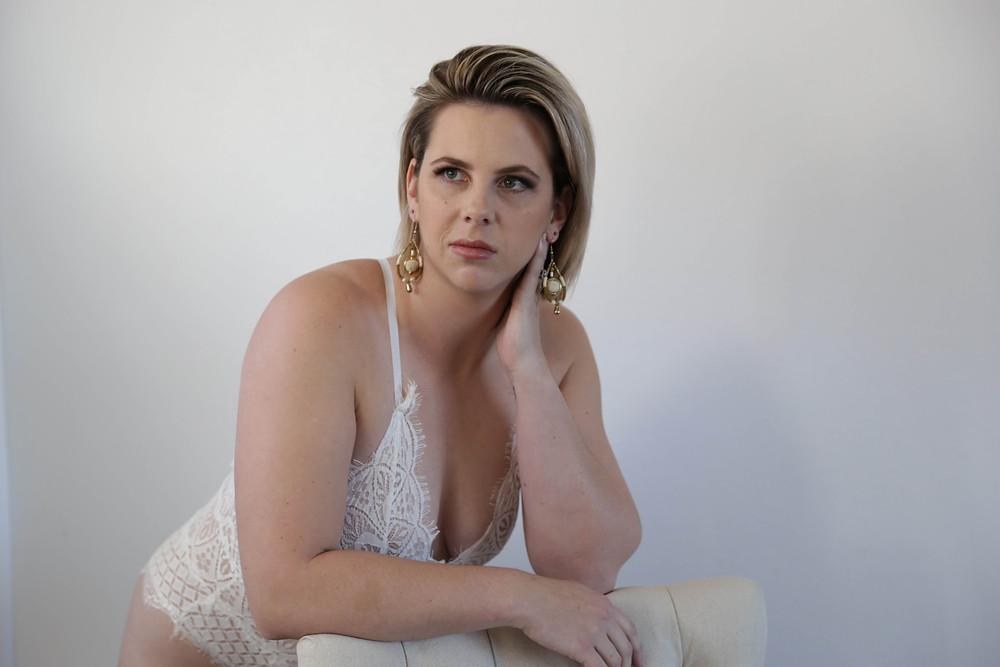 Sexy lingerie model wearing white bodysuit in Australia