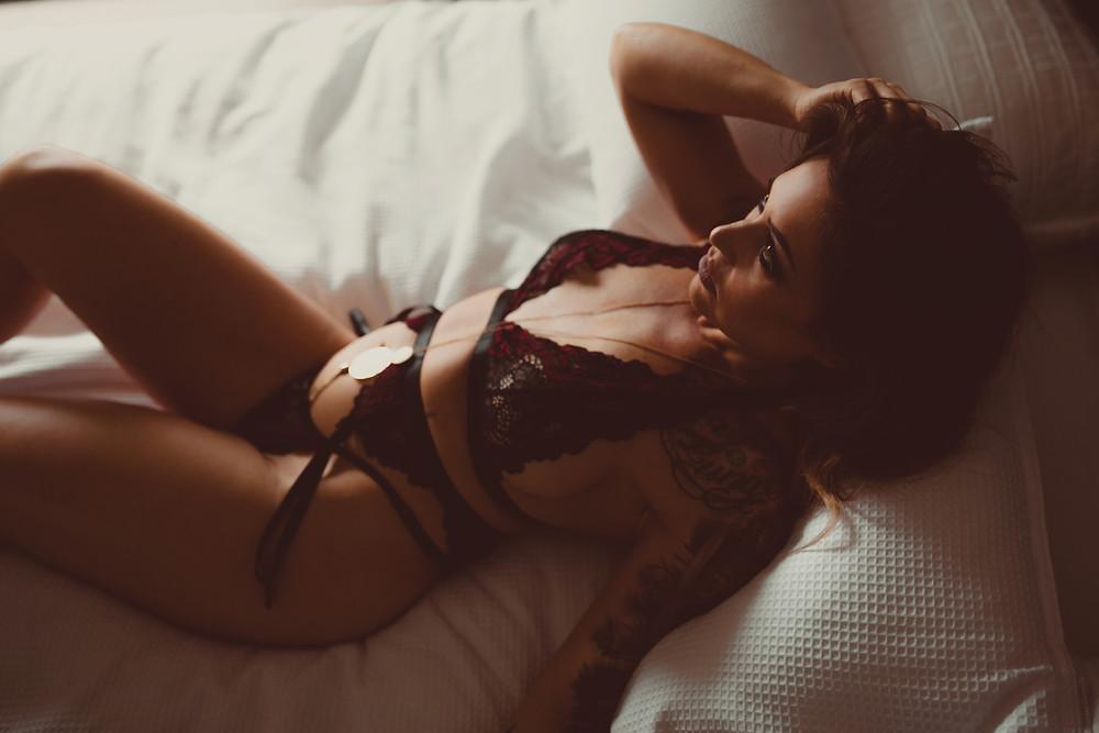 Lingerie model wearing black lace plus size lingerie set
