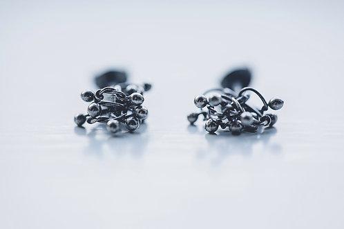 Oxidised knot studs