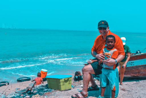 La Tierra Bomba - Pastor Bob & boy.jpg