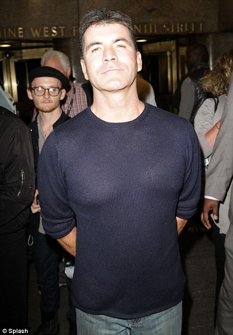 3. Simon proudly displays his moobs in an ill fitting jumper.