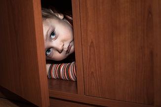 Boy hiding.jpg