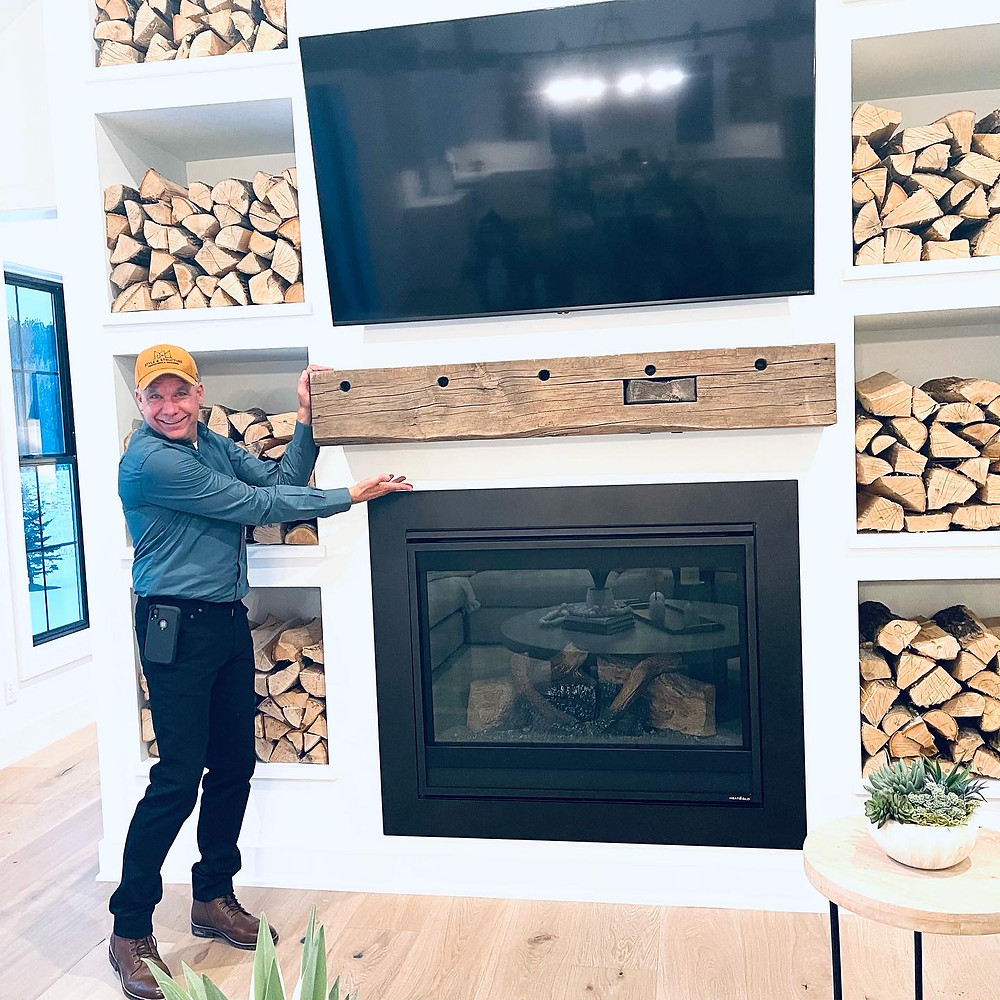 Stacked wood Fireplace with rustic mantel