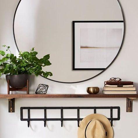 black circular mirror coat rack