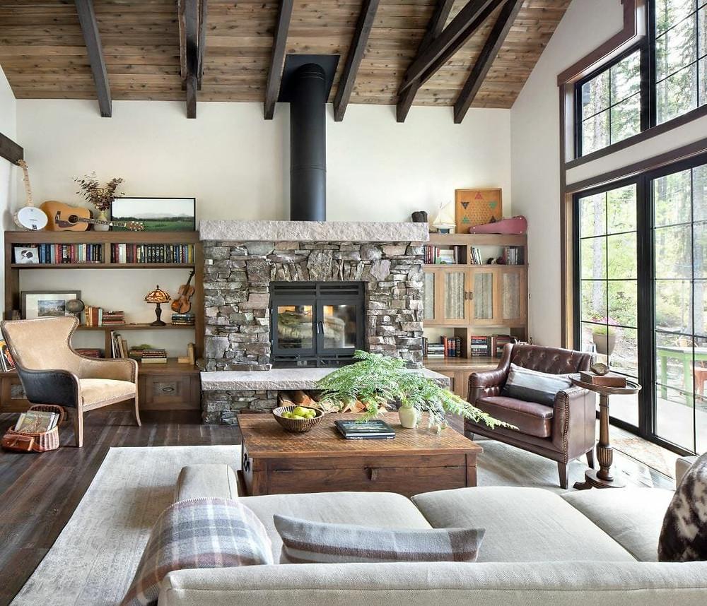 stone fireplace wood beams black windows