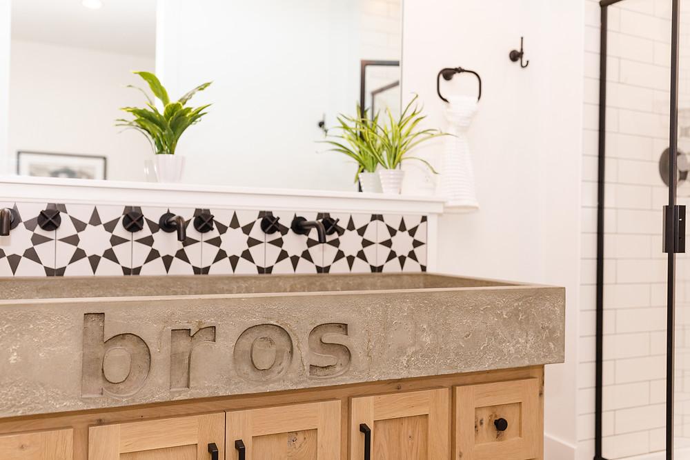 concrete trough sink stamped concrete white oak custom cabinets kids bathroom