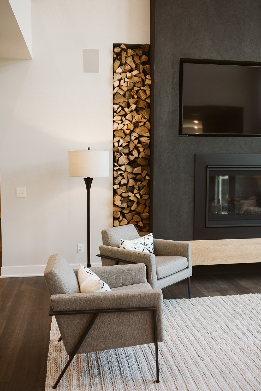 stacked firewood niche, black stucco fireplace