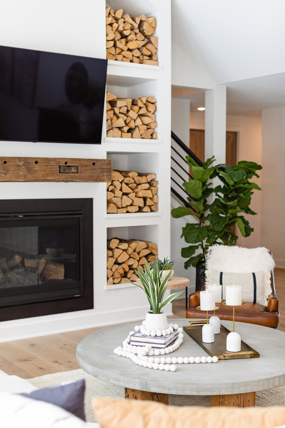 Stacked firewood, concrete round table, rustic mantle