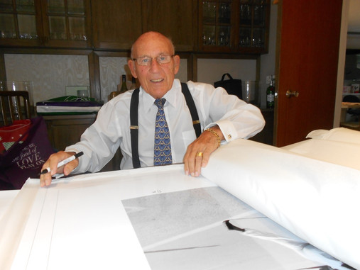 Sir Stirling Moss signing the exclusive Fine Art photograph «Le Mans Start 1958»