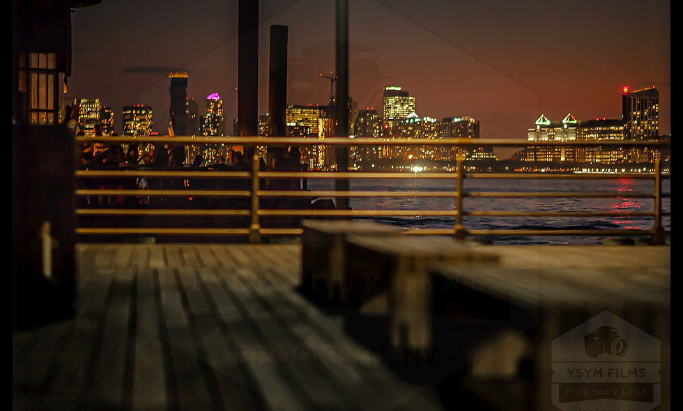 Night shot of the city from 23rd wood wheel boat deck