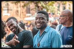 Two darkskin dudes smiling.jpg