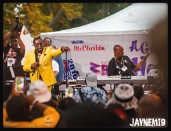Levert of the O'Jays hand on mic stand shot.jpg