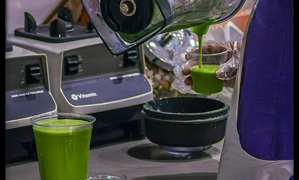 Green smoothie poured into a smoothie cup stock photo