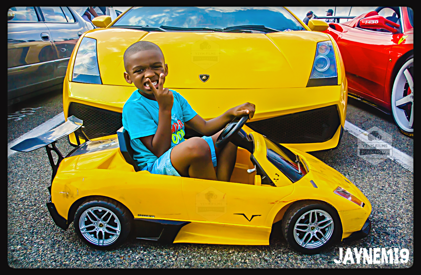 Kid lambo on deck with big lambo