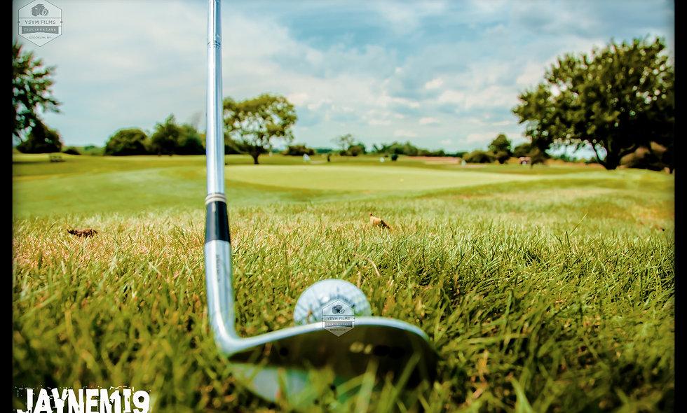 Golf wedge near green.