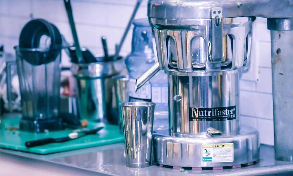 Nutrifaster juice machine & juice cup stock photo