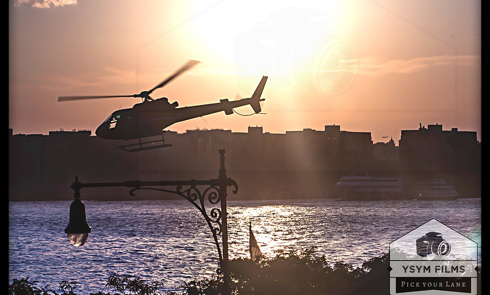 Silhouette Chopper flying away during a night sunset