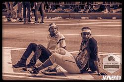 Two fellas sitting in the street chillin.jpg