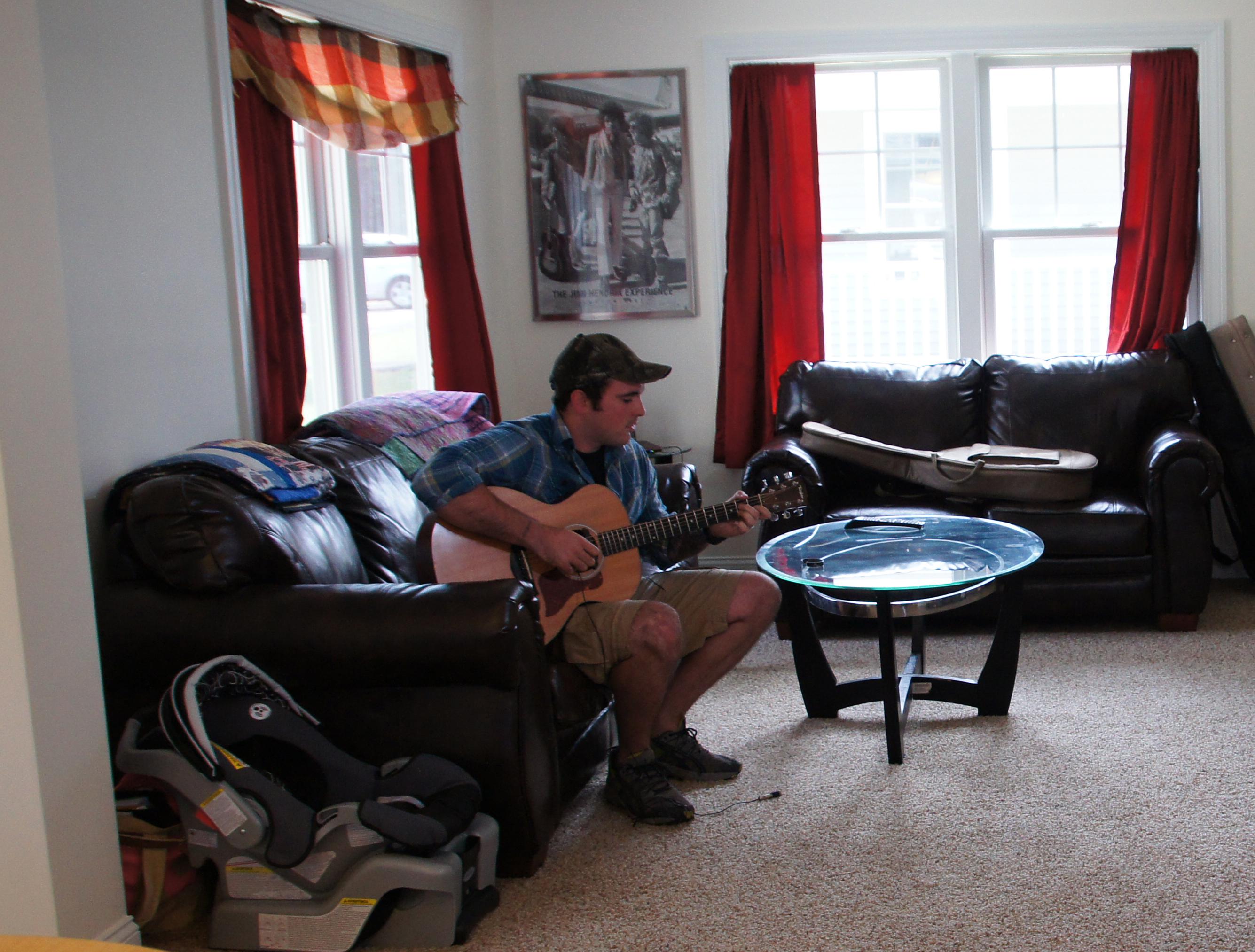 NVTRC vet playing guitar