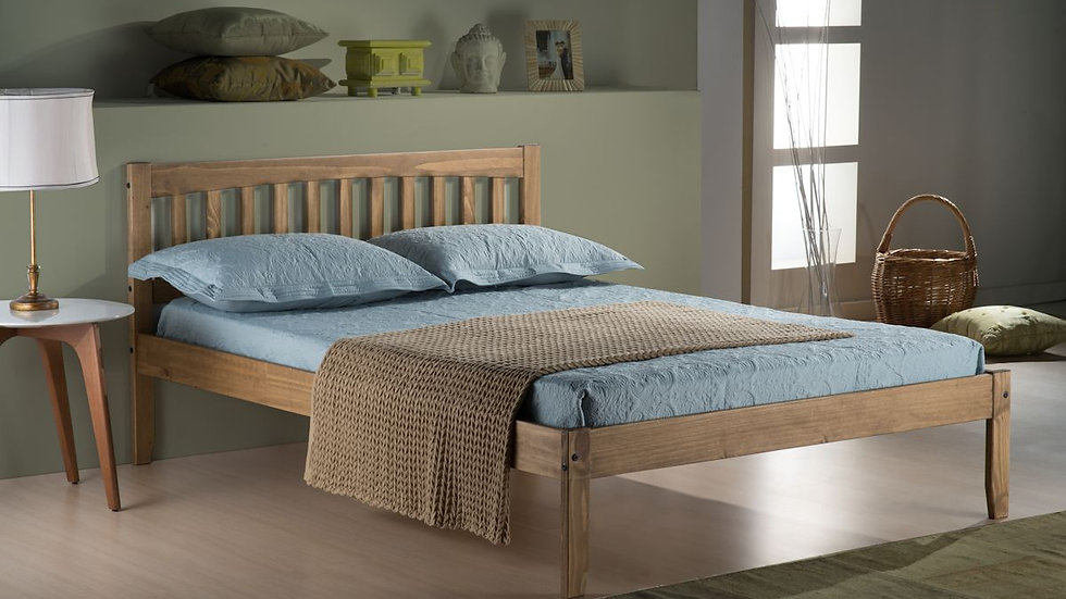 A Traditional Waxed Pine Bed Frame With A Rustic Feel