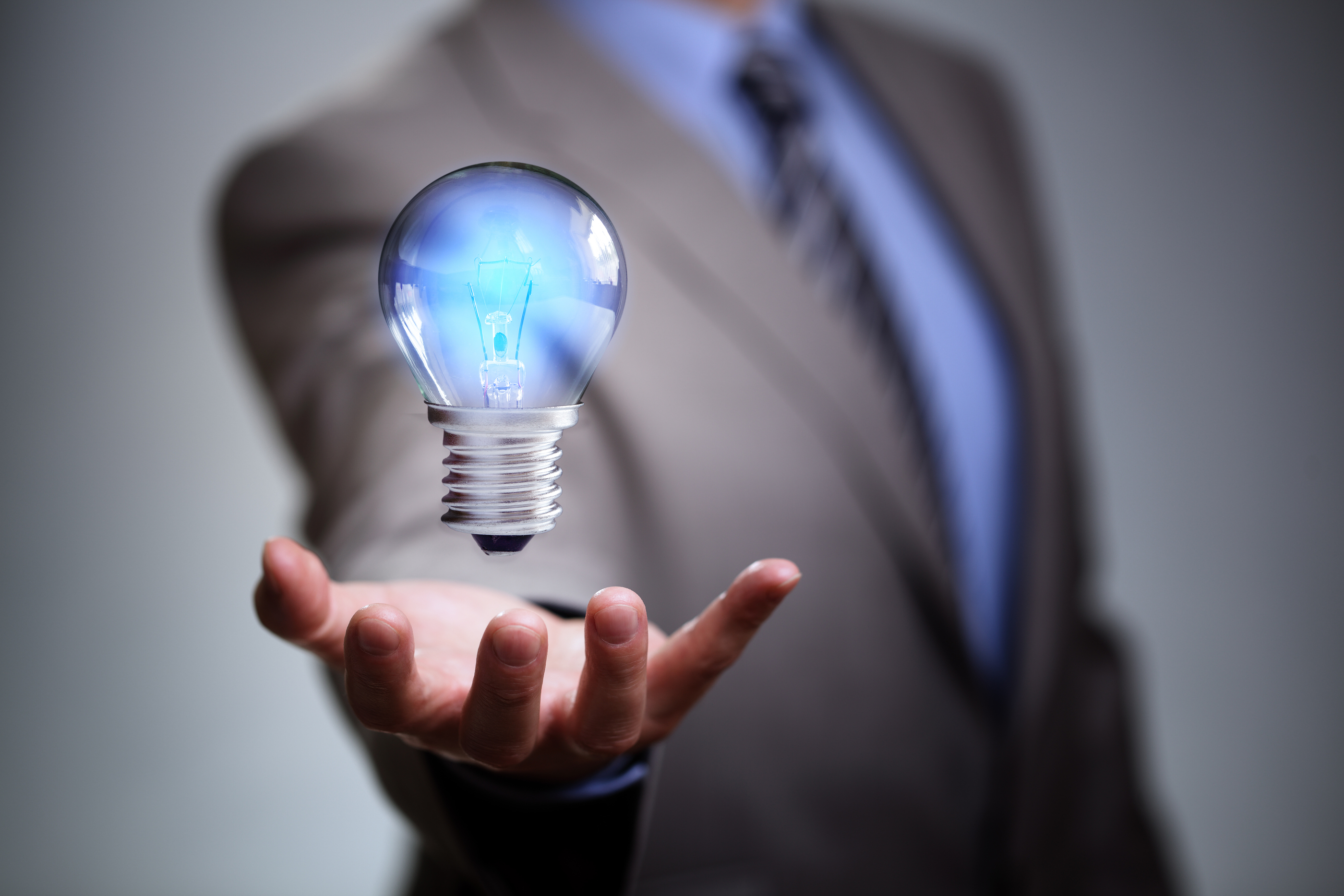 Businessman with illuminated light bulb concept for idea, innovation and inspira