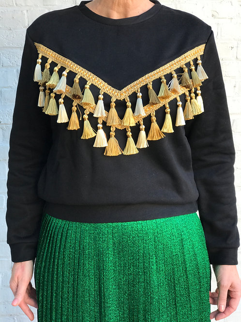 Black sweater with golden tassels