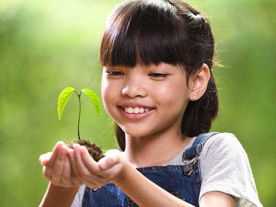 girl-holding-young-plant.jpg