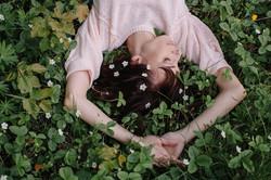 Stocksy-woman-sleeping-flowers-Liliya-Rodnikova-1.jpg