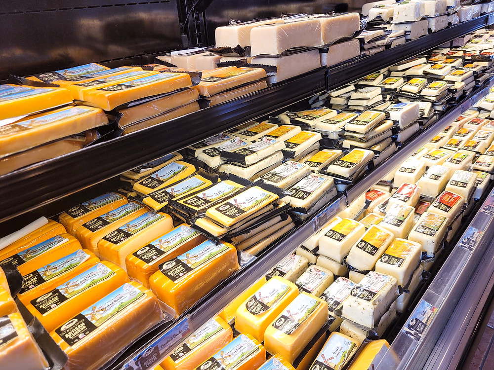 Different types of cheese in display cooler