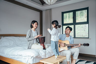 happy-family-playing-instruments-in-bedr
