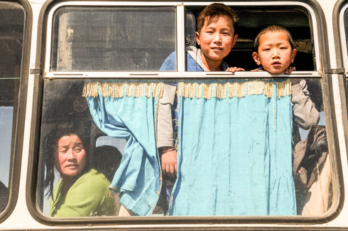 Children on bus in the Gobi Desert, Mongolia