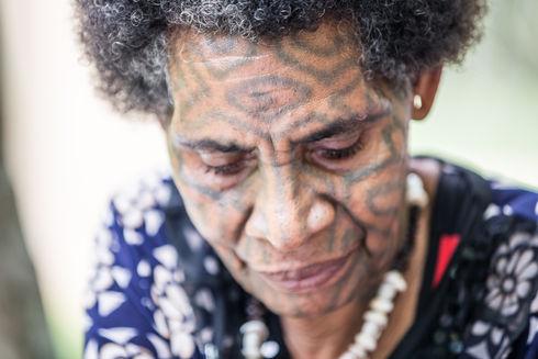 Face tattooed woman, Papua New Guinea