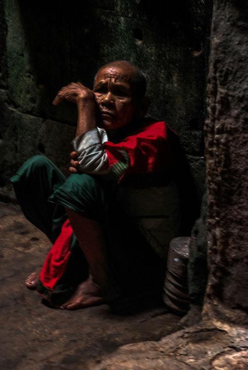 Monk in temple at Angkor Wat, Cambodia