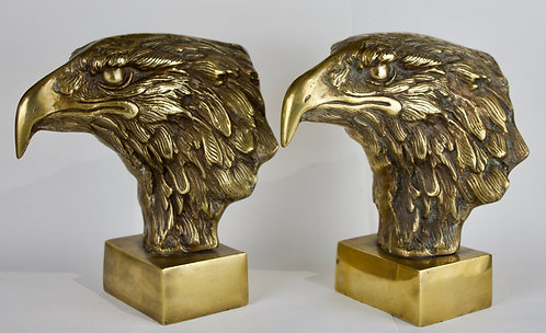 A Pair Of Sculptured Eagle Heads