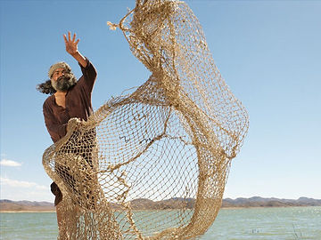 Simon Peter casts a fishing net into the Sea of Galilee. This net is a loose metaphor for researching theology & ministry information on the internet.